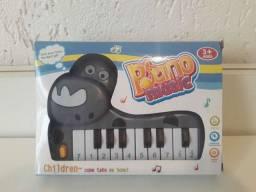 Pianinho musical infantil de Hipopótamo