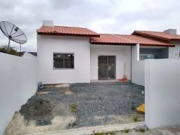Vendo casa em Penha com amplo espaço de quintal