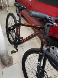 Bike esportista preta com laranja novíssima.