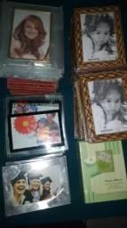 66 porta retratos... 2 álbuns de fotos bebê. Tudo novinho.
