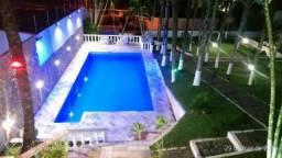 Casa na praia com piscina aquecida, sauna, hidromassagem, salão de jogos, ar condicionado