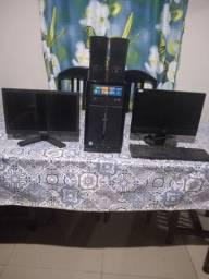 Computador e 2 monitor com teclado e caixinha de som