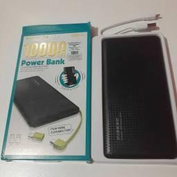 Carregador portátil de 10000 mah,  acompanha cabo usb e adptador para iphone.