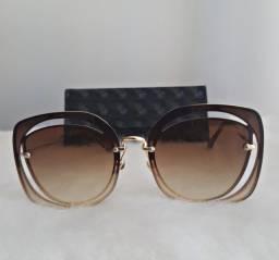 Óculos de sol miu miu novo