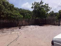 Sitio na beira de um braço do mar na praia da Caponga