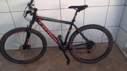 Bicicleta CXR Aro 29 Freio a Disco Mecânico MTB 21v - Lotus - Preto+Vermelho<br><br>