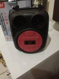 Caixinha de som bluetooth entrada usb aux. Radio suporte pra por celular. Luz de led