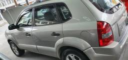 Tucson 2009 manual com gnv
