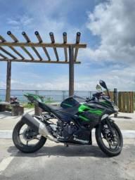 Kawasaki ninja 400cc .Troco por carro de mesmo valor ou abaixo dela  tabela 27