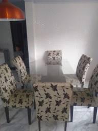 Mesa de jantar de vidro com 6 cadeiras muito conservada,almofadadas
