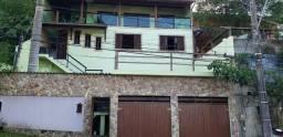 Casa com piscina em Camboinhas
