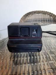 Máquina fotográfica antiga polaroid  relíquia