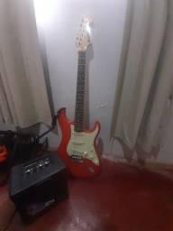Guitarra nova Memphis MG-32 festa red+amplificador,correia,cabo,palheta