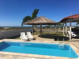 Casa Praia com piscina de frente para o mar