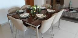 Mesa usada com 6 cadeiras, tampo de vidro e base em Inox