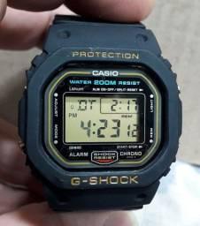 Relógio Casio Gshock DW 5600 série ouro fundo rosca