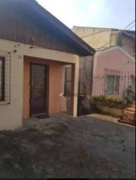 Casa com 3 dormitórios para alugar, 80 m² por R$ 1.610,00/mês - Vila Jardim - Porto Alegre
