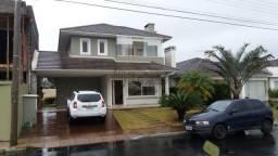Casa de condomínio para alugar com 4 dormitórios cod: *