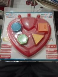 Monta Monta brinquedo educativo pra desenvolver e estimular a Criança novo embalada.
