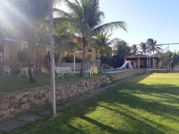 Casa em condomínio com 3 dormitórios à venda, 119 m² por R$ 295.000 - Porto das Dunas - Aq