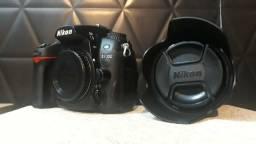 Câmera e lente Nikon