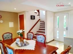Casa em condomínio, tipo triplex, com 3 dormitórios com 2 vagas no bairro Vila Jardim.