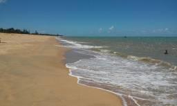 Relaxe com lote de frente à praia, 300m², em Nova Viçosa
