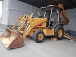 Retroescavadeira Case 580