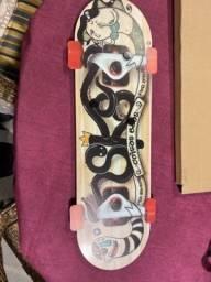 Título do anúncio: Porta fotos marca Uatt em forma de Skate com imã