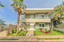 Sobrado com 5 suites à venda, 402 m² por R$ 3.500.000 - Estância Velha - Canoas/RS