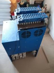 2 maquinas de fabricação de velas de parafina