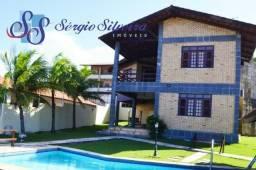 Casa para venda no Porto das Dunas com 5 suítes, piscina e deck com churrasqueira