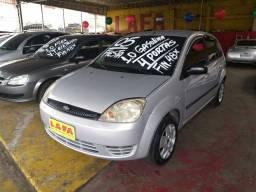 Ford/ Fiesta Hatch 1.0 gasolina 4pts, prata , vidros e travas elétricas