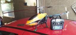 Título do anúncio: Troco helicóptero de controle remoto por extratora de mano