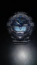G-shock, fundo azul, Valor 750 OU  TROCO