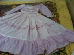 Vestido de prenda infantil rosa de tecido