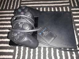 PlayStation 2, com 2 controles, memory card 8mb, e uma capa pra guardar jogos