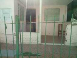 Vendo casa de material em corredor sala, cozinha , banheiro ,dois quartos e área grande