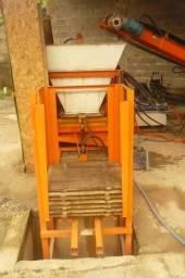 Maquina de fabricar blocos cimento