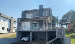 Título do anúncio: Sobrado com 3 dormitórios à venda, 140 m² por R$ 750.000,00 - Villa Lucchesi - Gravataí/RS