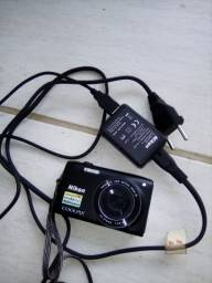 Máquina fotográfica.