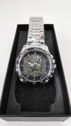 Vejam as fotos! Relógio mecânico! C/ caixa original. Modelos importado!