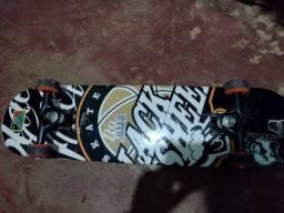 Skate semi novo com tudo original