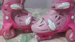 Patins rosa com kit é bem conservado