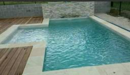 Construção de piscinas, áreas de lazer, campo de futebol