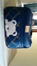 Título do anúncio: Bolsa grande é pequena e um porta mamadeira azul