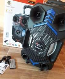 Som Bluetooth com rodinhas + microfone frete grátis