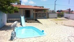 Casa em JACUMA com piscina sendo 4 lotes vista mar.