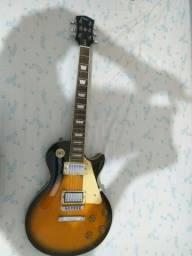 Título do anúncio: Guitarra shelter Nashville, americana, com amplificador e pedal simples,