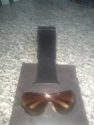 vendo oculos de sol da marca prada novinho